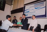 Honorable State Minister for Education, Mr. Ehsanul Hoque Milan giving prizes to the winners of the essay competition contest, organized by the Institute of Hazrat Mohammad (SAW), for school children, on the life of Prophet Mohammad (SAW).